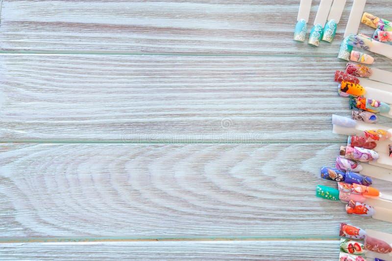 图画的例子在钉子的在蓝色背景 图库摄影