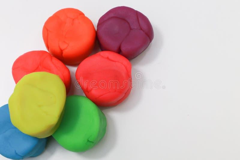 图象的五颜六色的playdough关闭在白色背景 库存图片