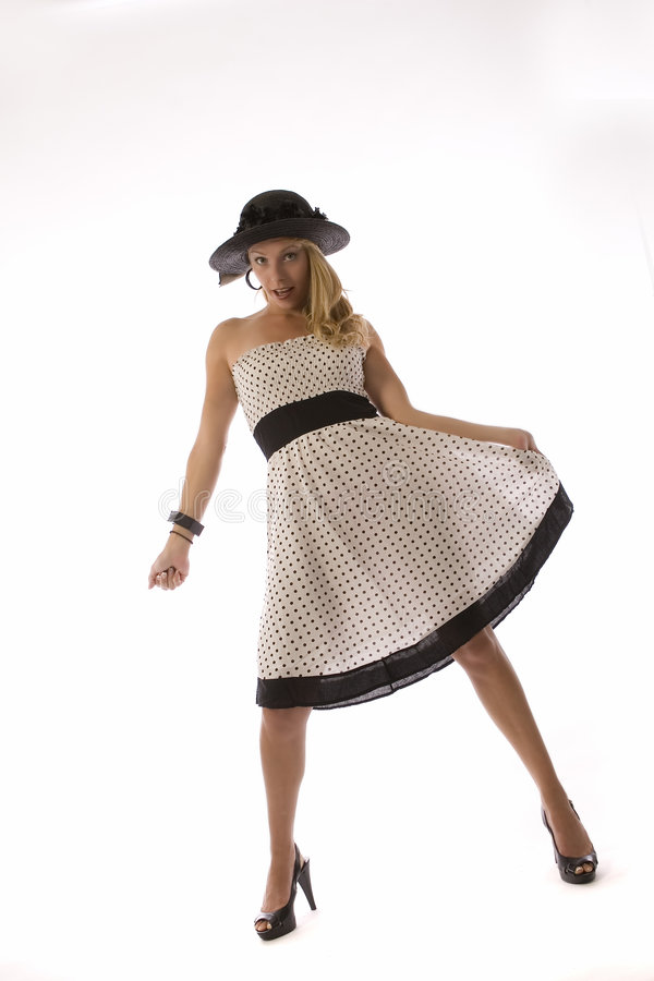 圆点花样的布料礼服的妇女 库存照片
