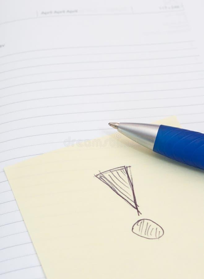 圆珠笔通知单笔记本棍子 免版税库存照片