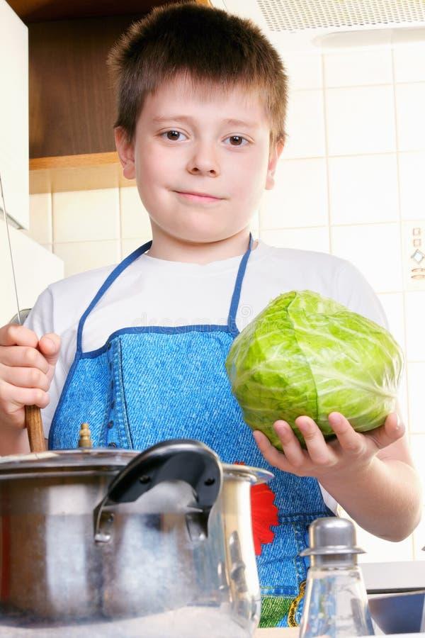 圆白菜孩子刀子 库存照片
