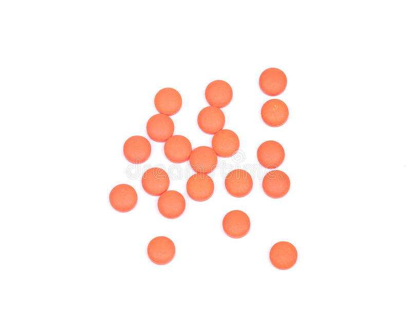 圆的橙色药片 免版税库存照片