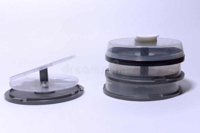 圆盘的空的塑料存贮 有透明罩的管 库存图片