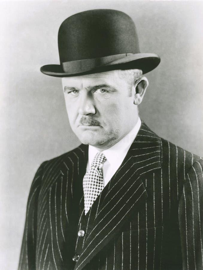 圆顶硬礼帽的精致的人 免版税库存图片