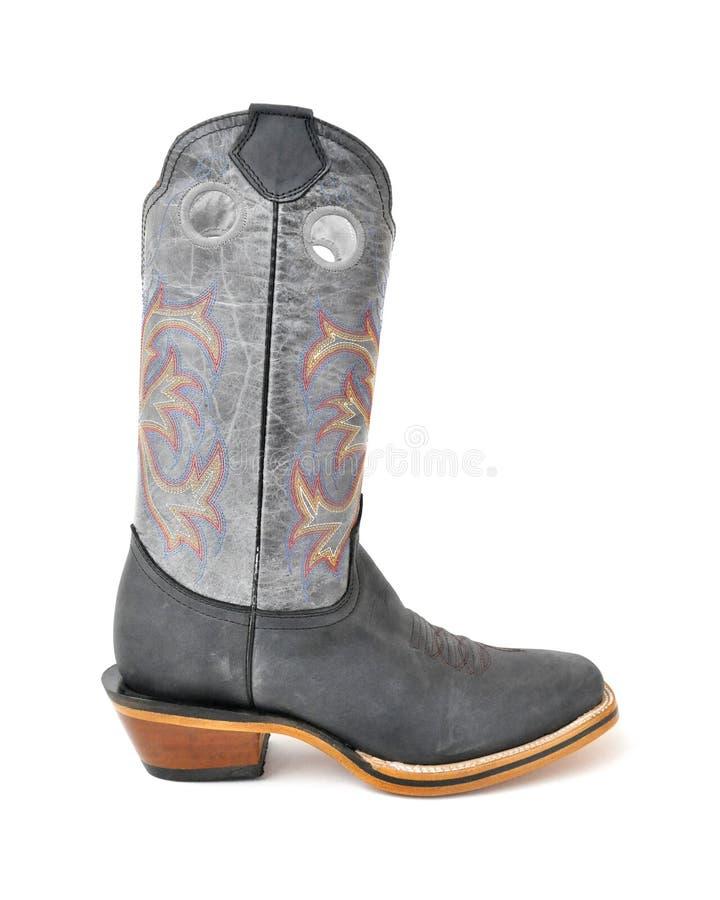 圈地样式牛仔靴 免版税库存照片