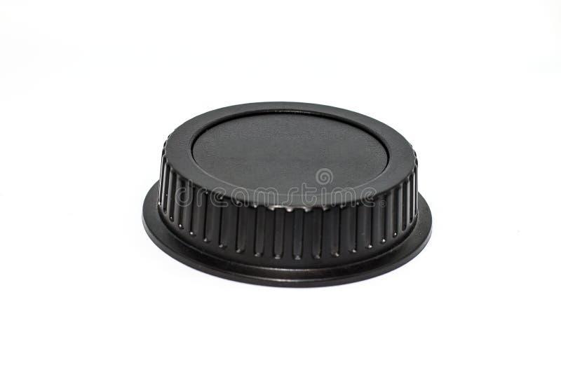 黑圈子照相机len在白色背景的盖帽 免版税库存照片
