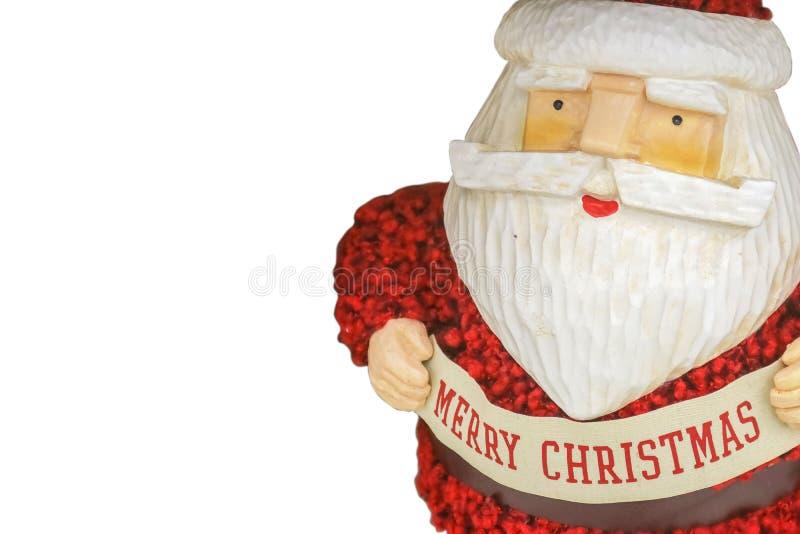 土气五颜六色的木刻圣诞老人和蓬松编织衣服-拷贝的室白色背景与圣诞快乐横幅的 免版税库存照片