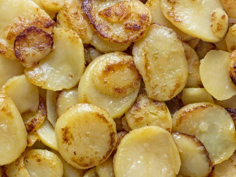 土气德语bratkartofflen油煎的土豆 库存图片
