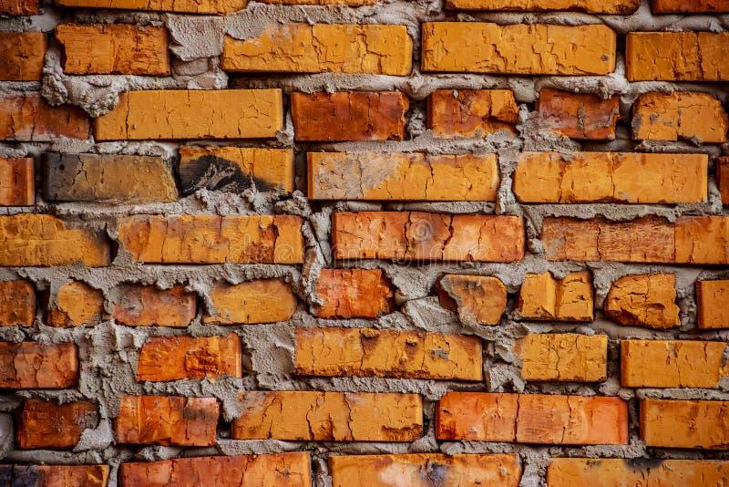土气橙色砖墙/背景 免版税库存图片