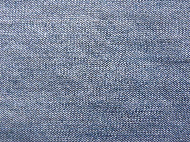 土气难看的东西蓝色葡萄酒牛仔布牛仔裤背景 免版税库存照片
