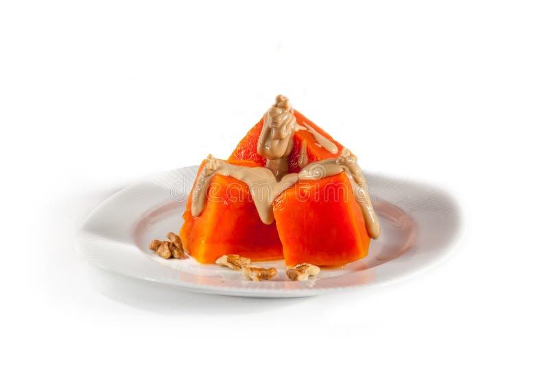 土耳其传统南瓜甜点心kabak tatlisi被隔绝的白色背景 库存照片