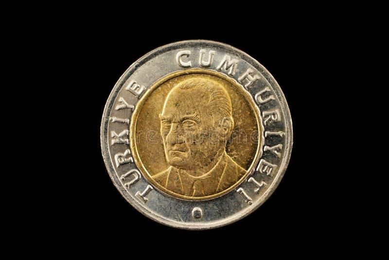 土耳其语在黑色隔绝的一里拉两种金属的硬币 免版税库存照片