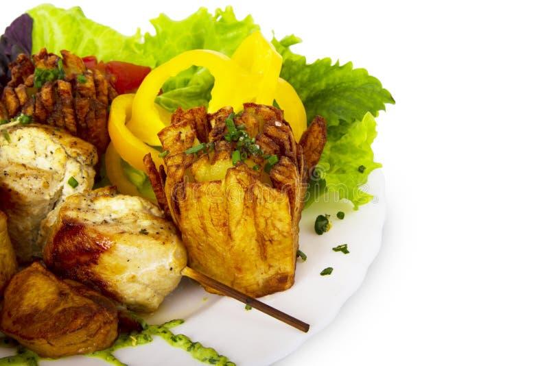土豆和油煎的肉 库存图片