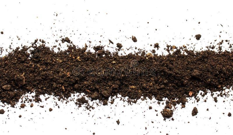 土,在白色背景隔绝的土壤堆 免版税库存图片
