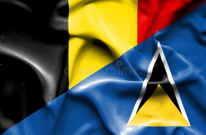 圣卢西亚和比利时的挥动的旗子 皇族释放例证