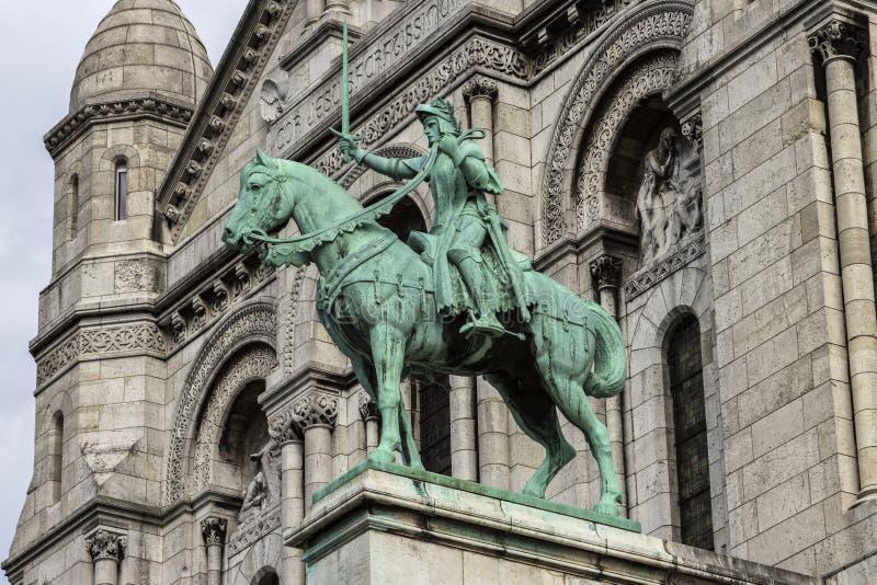 圣徒圣贞德骑马雕象  Sacre-Coeur 库存照片