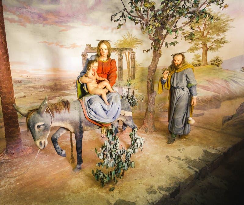 圣母玛丽亚和埃及圣经的场面表示法presepe的基督孩子 免版税图库摄影