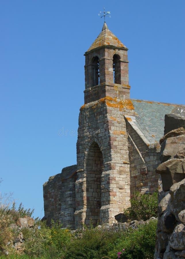圣洁海岛的一个老Medevil英国教会 库存图片