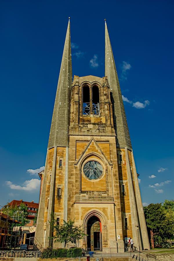 圣约翰新教徒教区教堂在日落期间的在天空蔚蓝,维尔茨堡,巴伐利亚,德国,夏时 免版税库存图片
