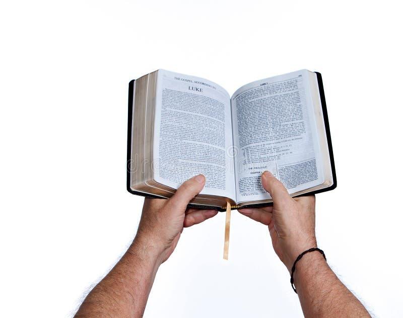 圣经在手上 免版税图库摄影