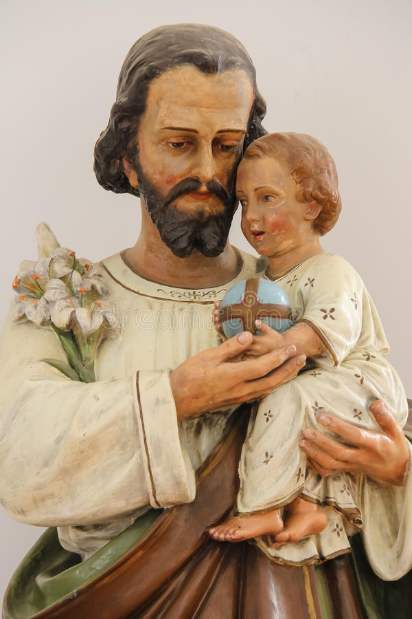 圣若瑟雕象和Palanok城堡的, Muka小耶稣 库存图片