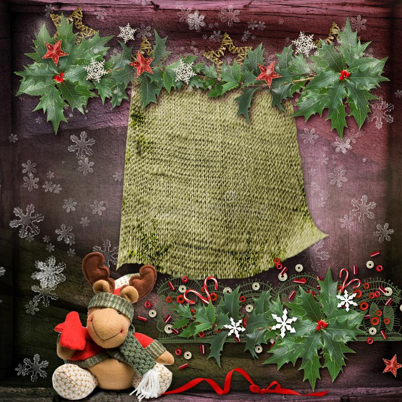 圣诞卡片与一个装饰的绿色分支和玩具和与文本的一个空的地方 免版税库存照片