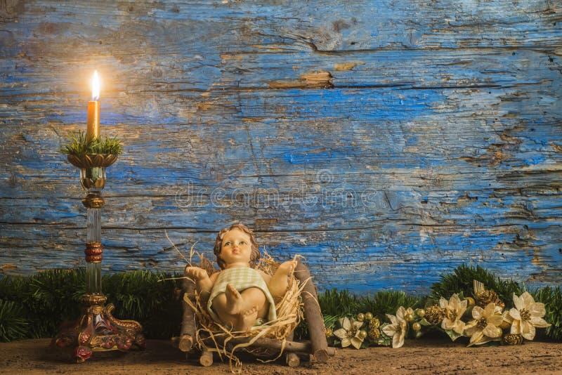 圣诞卡,他的小儿床的小耶稣 免版税图库摄影