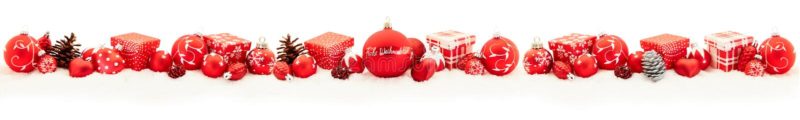圣诞快乐在红色的全景框架 库存照片