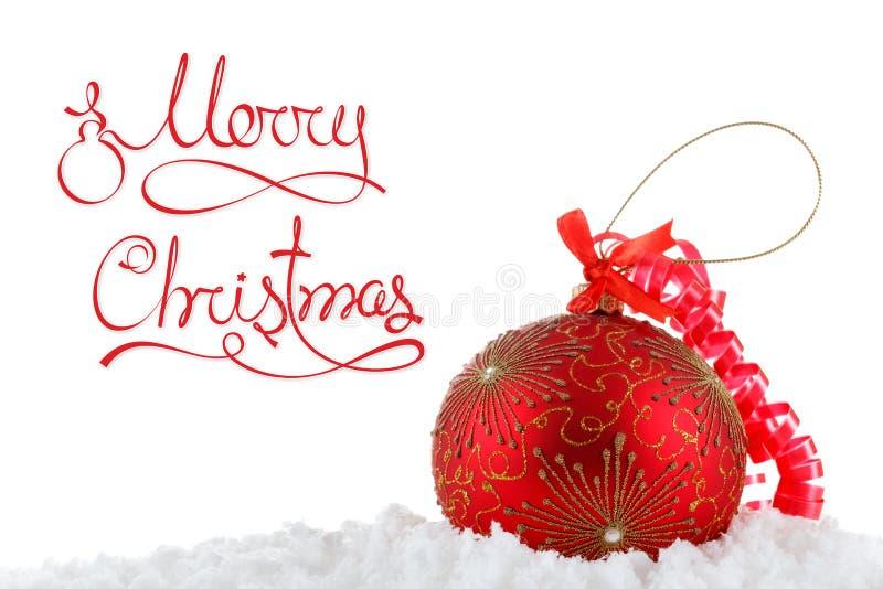 圣诞快乐在雪的概念球,招呼 免版税库存照片
