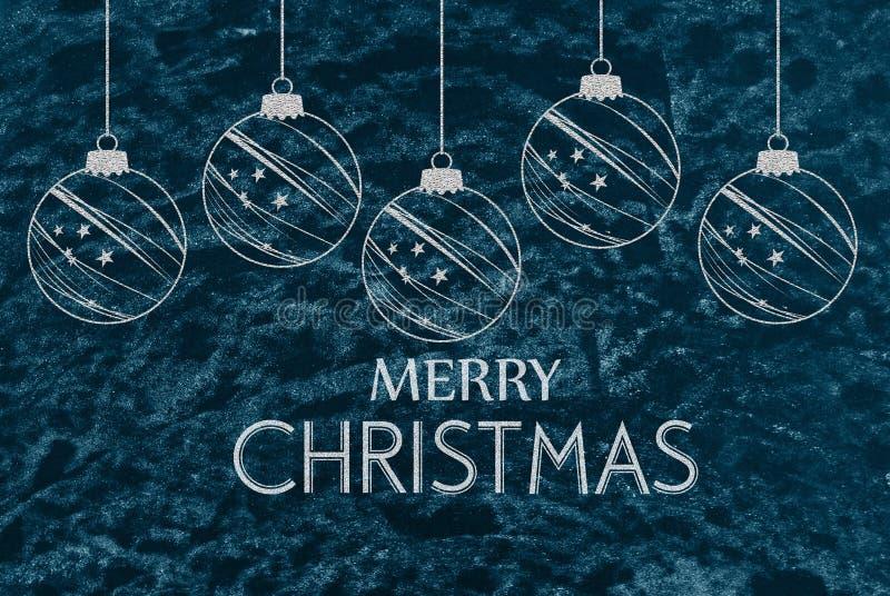 圣诞快乐问候-在蓝色黑板在背景中 免版税库存照片