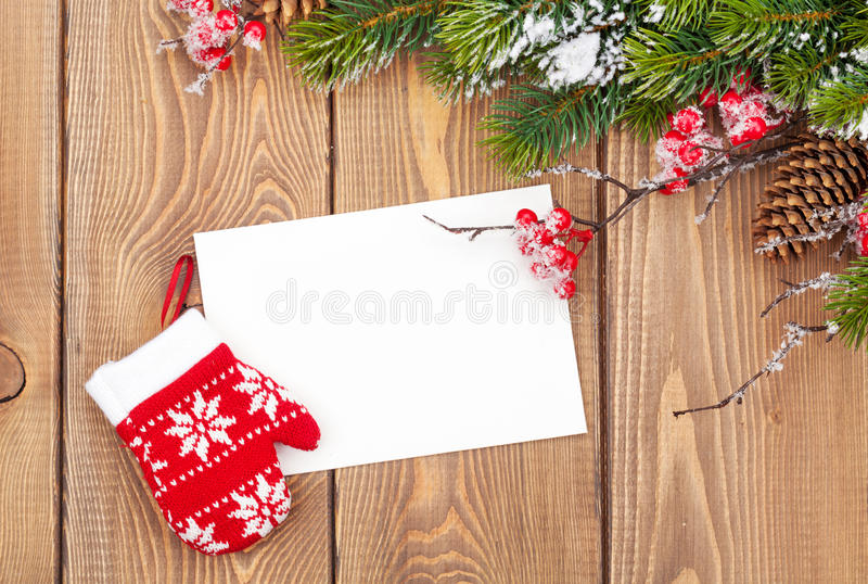 圣诞树分支和空白的贺卡 免版税库存照片