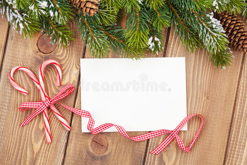 圣诞树分支和空白的贺卡 图库摄影