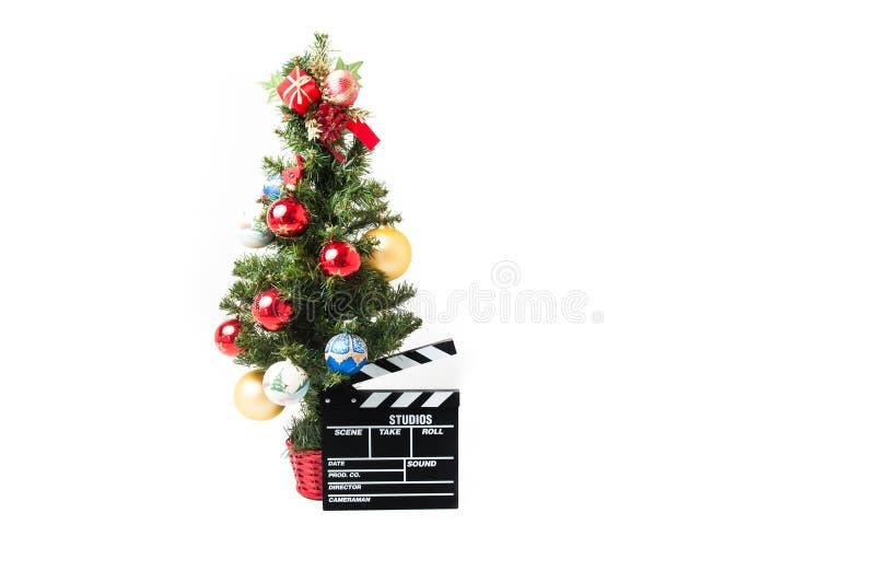 圣诞树和电影clapperboard 免版税库存图片