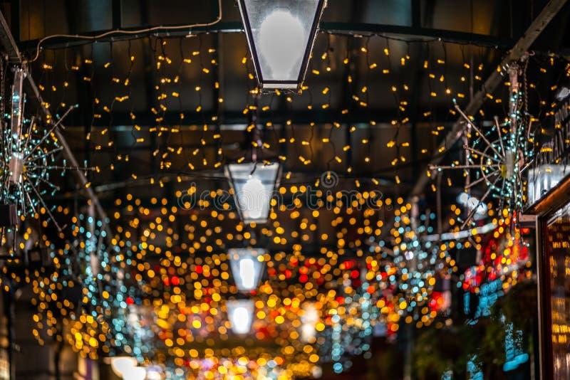 圣诞灯Bokeh在科文特花园市场上 库存照片