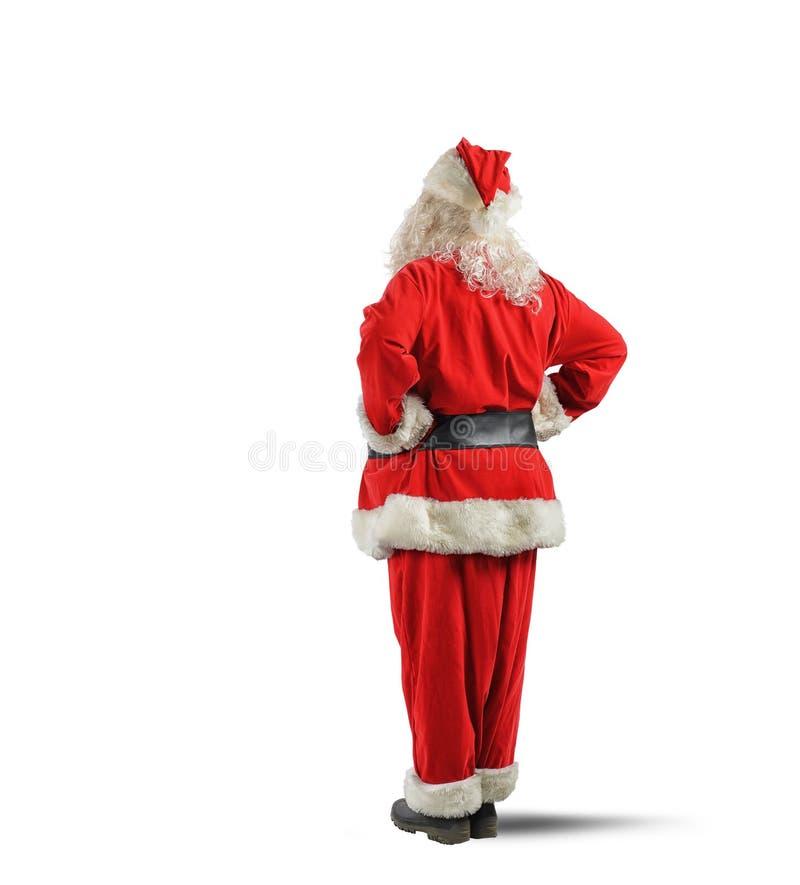 圣诞老人后面 库存图片
