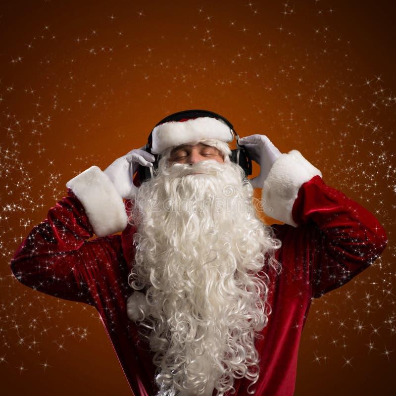 圣诞老人听到音乐 库存图片