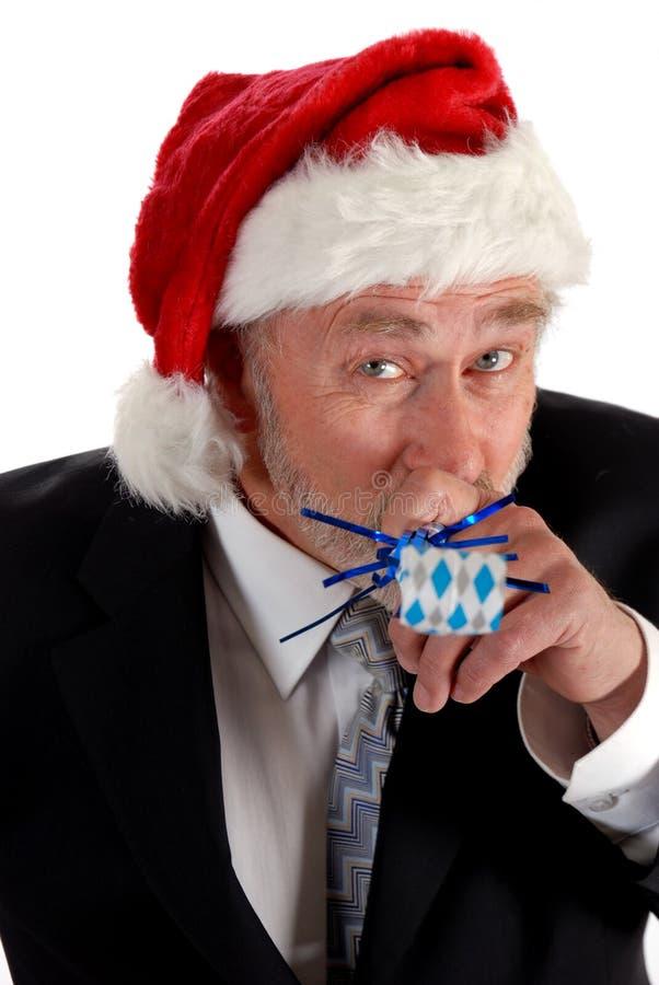 圣诞老人吹的当事人玩具 库存图片