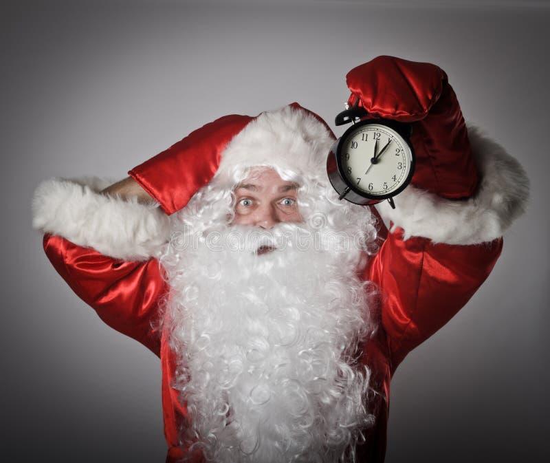 圣诞老人和时钟 免版税库存图片