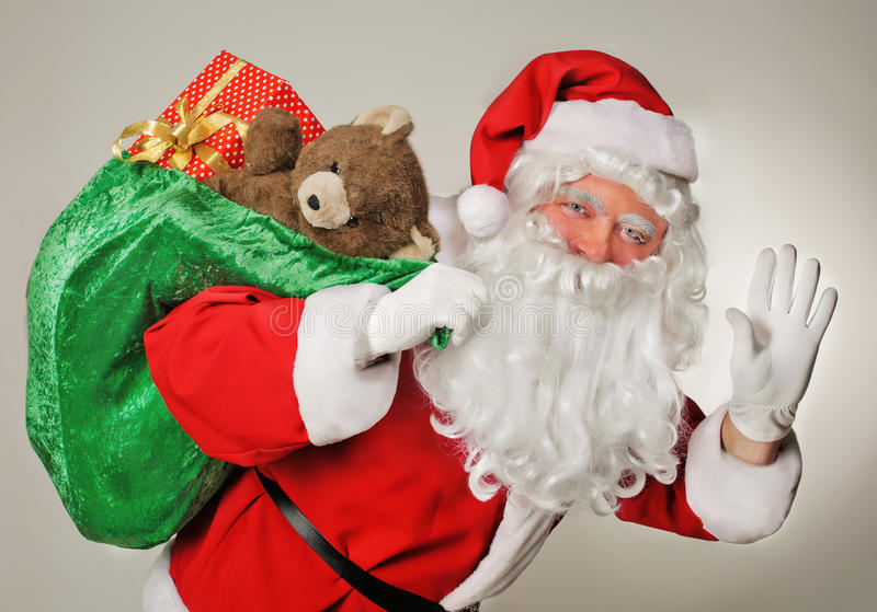 圣诞老人和礼物袋子 图库摄影