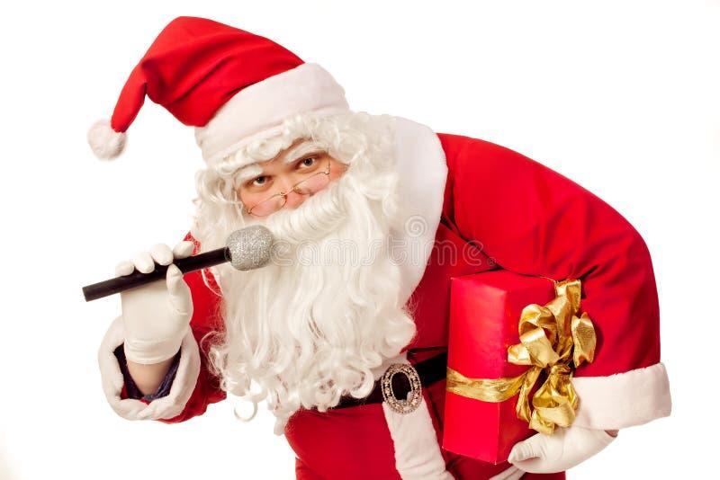 圣诞老人唱歌 库存照片