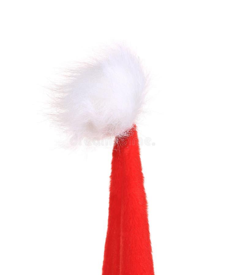 圣诞老人圆锥形红色帽子上面。 免版税库存图片