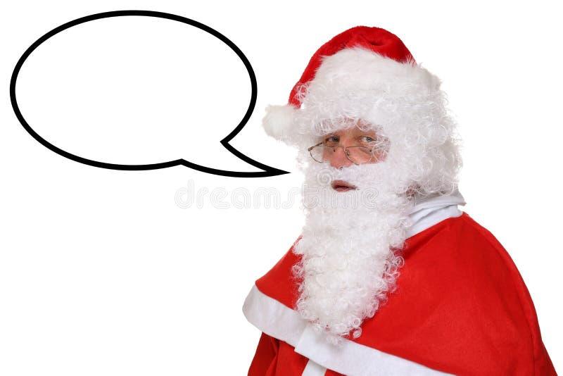 圣诞老人圣诞节讲话与讲话泡影和copyspace 库存照片