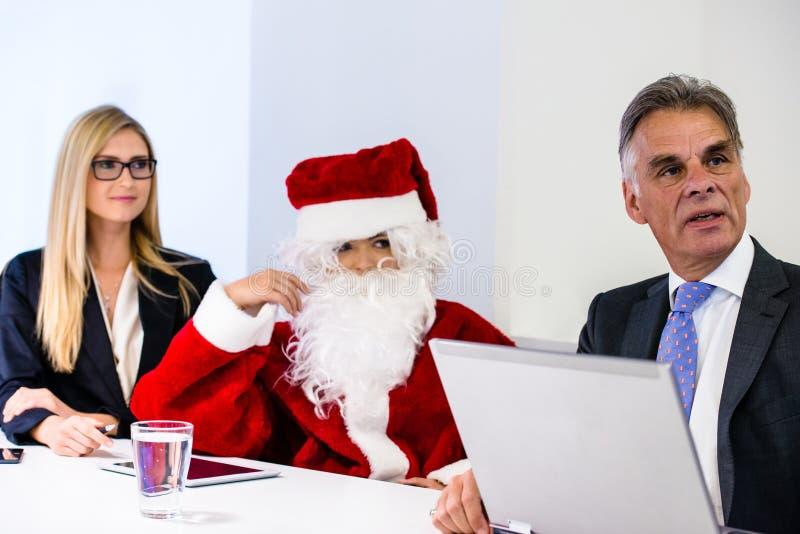 圣诞老人在业务会议 免版税库存图片