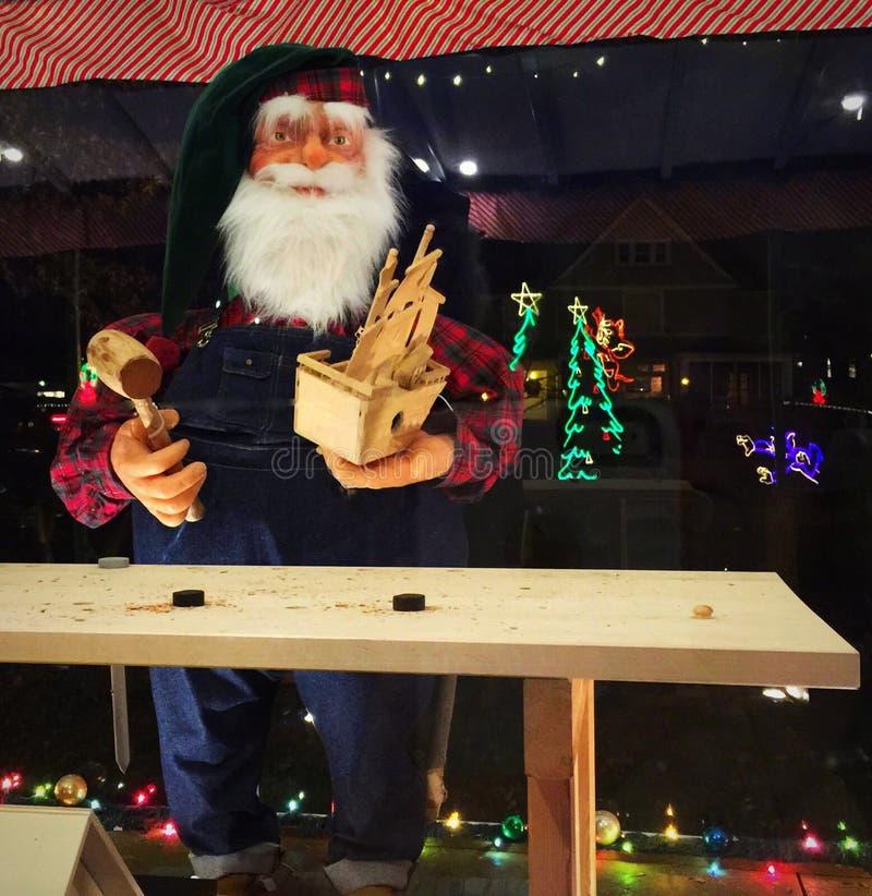 圣诞老人在车间 库存照片