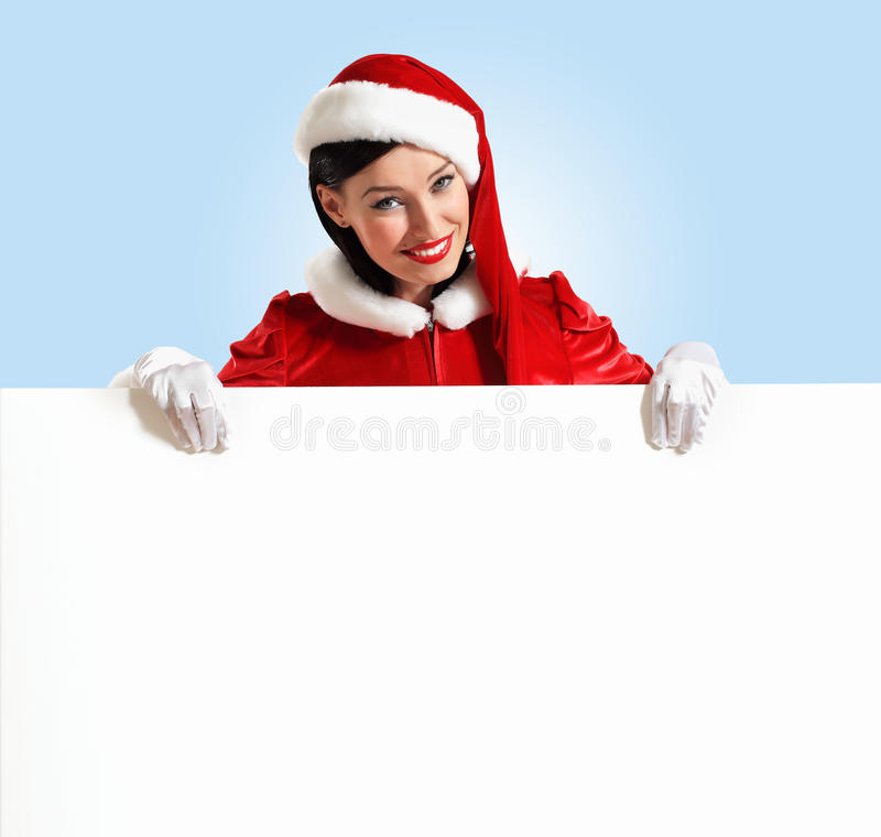 有一副空白的横幅的圣诞老人女孩 免版税库存照片