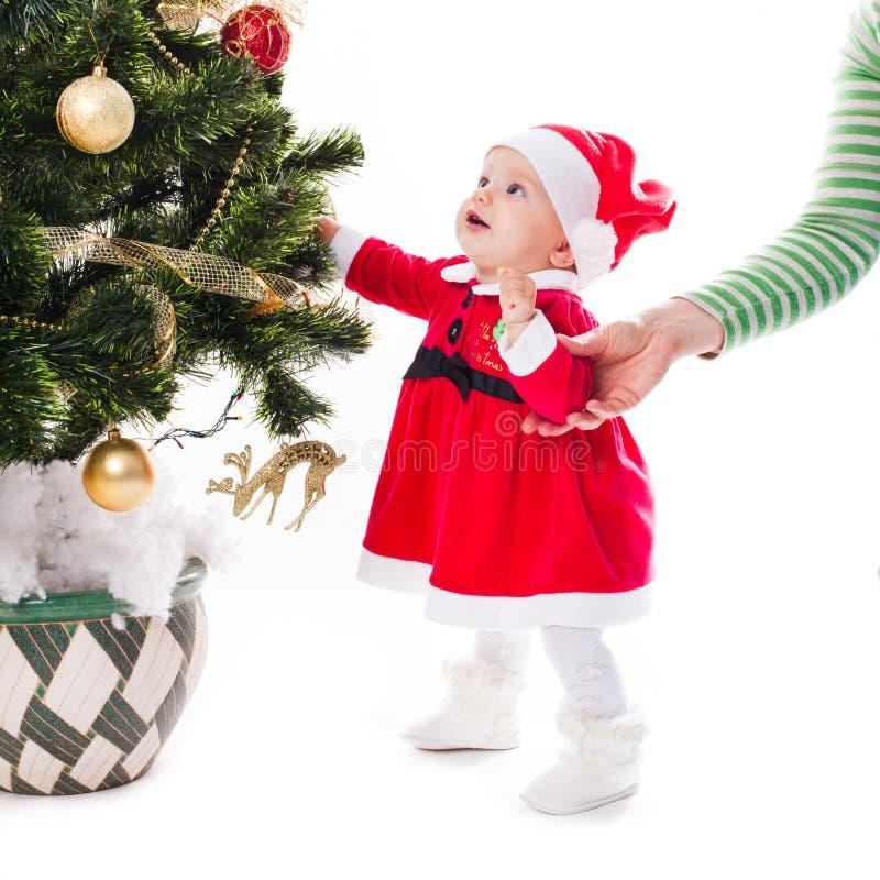 圣诞老人女婴 库存照片