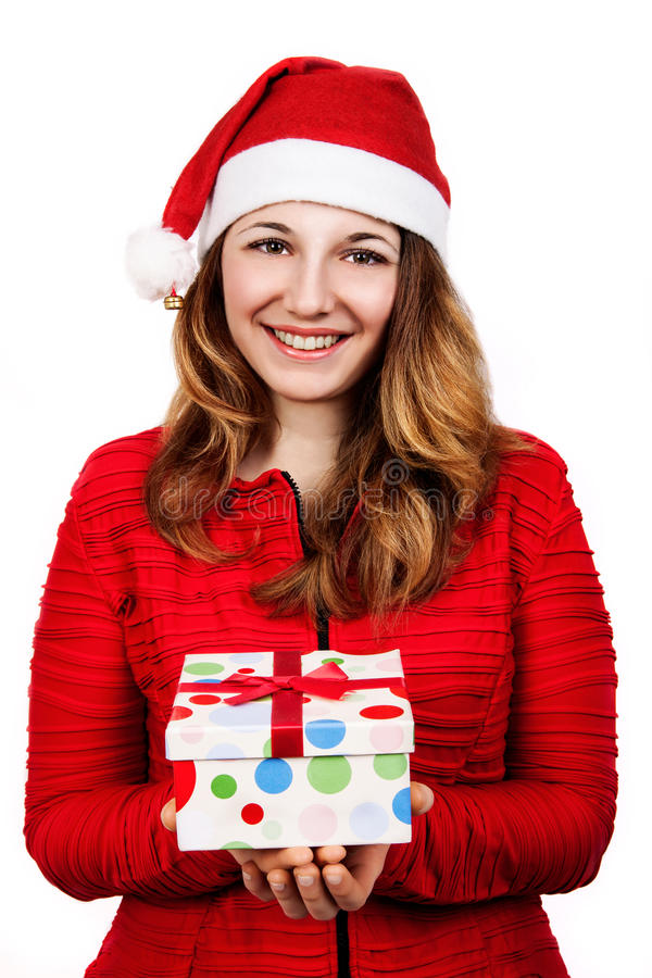 圣诞老人帮手帽子的微笑的妇女有许多礼物盒的 图库摄影