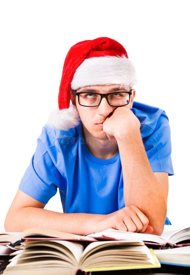 圣诞老人帽子的乏味学生 免版税库存照片