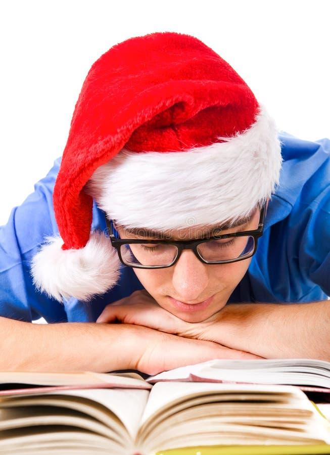 圣诞老人帽子的乏味学生 库存图片