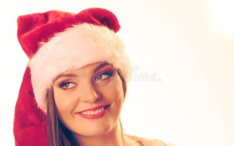 圣诞老人帽子的妇女 库存照片